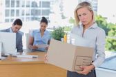 Upset businesswoman leaving office after being let go — Stock Photo