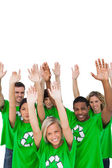 Cheerful group of environmental activists raising arms — Stock Photo
