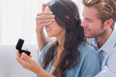 Man hiding his wifes eyes to offer her an engagement ring — Stock Photo