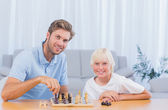 Little boy playing chess with his father — Stock Photo