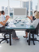 Business applauding during a video conference — Stock Photo