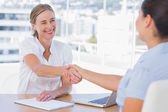 Smiling interviewer shaking hand of an applicant — Stock Photo
