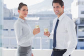 Smiling business clinking their flutes of champagne — Stock Photo