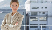 Businesswoman with arms folded in her office — Stock Photo