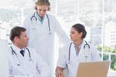 Group of doctors discussing and working together — Stock Photo