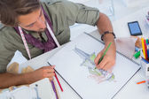 Fashion designer creating a coat for woman — Stock Photo