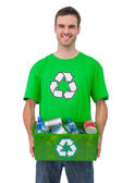 Attractive man holding box of recyclables — Stock Photo