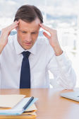 Anxious businessman holding his head — Stock Photo