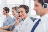Attractive call centre agent with a headset — 图库照片