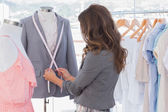 Fashion designer measuring blazer — Stock Photo