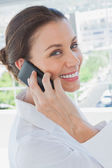 Cheerful businesswoman having a phone conversation — Stock Photo