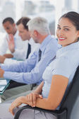 Pretty businesswoman posing in the meeting room — Stock Photo