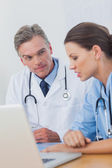 Doctor listening attentively to a colleague — Stock Photo
