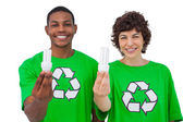 Environmental activists holding energy saving light bulbs — Stock Photo