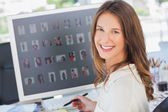 Portrait of a smiling photo editor — Stock Photo