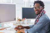 Portrait on a creative business worker on computer — Stock Photo