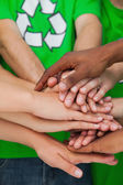 Activists piling up their hands together — Stock Photo