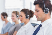 Group of agents sitting in line in a call centre — Stock Photo