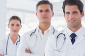 Three doctors with lab coats — Stock Photo
