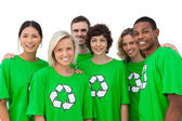 Group of smiling activists wearing green shirt with recycling sy — Stock Photo
