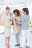 Fashion designers holding blazer — Stock Photo
