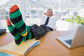 Business having a nap with feet on his desk — Stock Photo