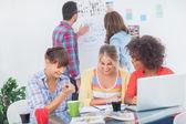 Designers having a brainstorm together — Stock Photo