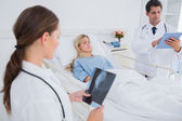 Doctors with xray and digital tablet — Stock Photo