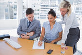 Businesswoman showing colleagues something on her notepad — Stock Photo