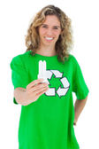 Cheerful environmental activist holding a light bulb — Stock Photo