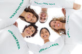 Low angle view of wearing volunteer tshirt — Stock Photo