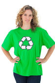 Environmental activist wearing green shirt with recycling symbol — Stock Photo