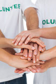 Volunteers putting hands together — Stock Photo
