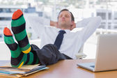 Businessman sleeping with feet on his desk — Stock Photo