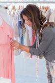 Fashion designer adjusting dress — Stock Photo