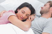 Woman sleeping on her husbands chest — Stock Photo
