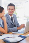 Smiling business look at each other — Stock Photo
