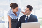 Business look at each other and smiling — Stock Photo