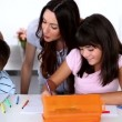 Stock Video: Children colouring with their parents