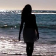 Silhouette of woman skipping on the beach — Stock Video