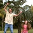 Happy father jumping on a trampoline with his daughter  — Stock Video