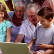 Family using laptop — Stock Video