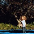 Little girl having fun on a trampoline — Stock Video