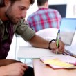Stock Video: Designers drawing together on their desk