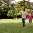 Stock Video: Family taking a walk in a park