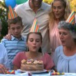 Happy family blowing the candles of birthday cake — Stock Video