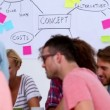 Vídeo de stock: Creative team interacting together