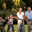 Multi-generation family posing in a park with their bicycles — Stock Video