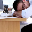 Stock Video: Creative designer napping on his desk