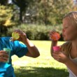 Cheerful siblings having fun together with bubbles — Stock Video